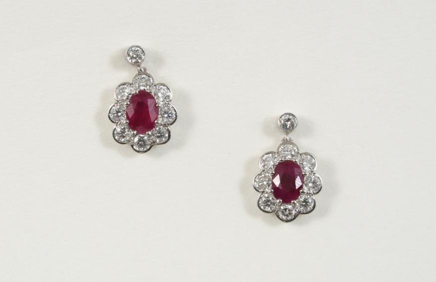 A PAIR OF RUBY AND DIAMOND CLUSTER DROP EARRINGS