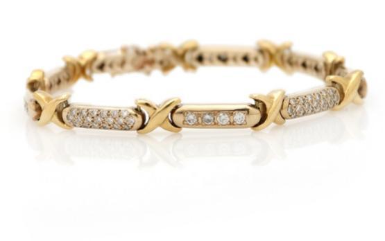 A diamond bracelet set with numerous brilliant-cut diamonds, mounted in 18k gold