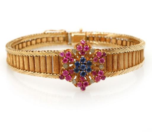 A ruby and sapphire bracelet set with numerous circular-cut rubies and sapphires