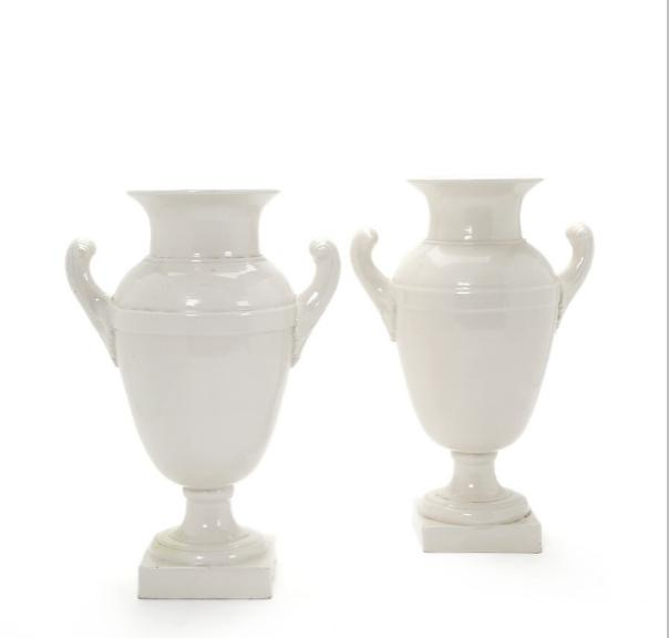 A pair of white glazed faience vases