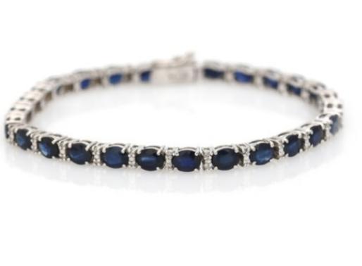 A sapphire and diamond bracelet set with numerous oval-cut sapphires and brilliant-cut diamonds