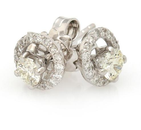 "A pair of ""Night & Day"" diamond ear studs each set with numerous diamonds"