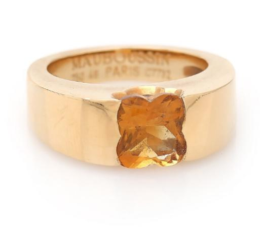 A citrine ring set with a fancy-cut citrine, mounted in 18k gold. Size 49.