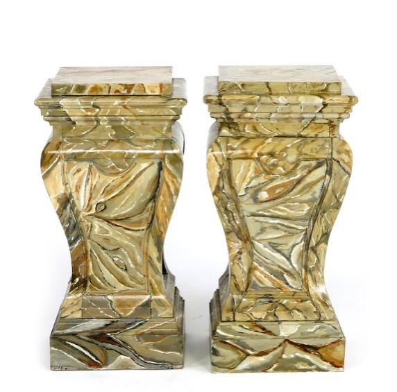 A pair of painted pedestals decorated with imitated marble