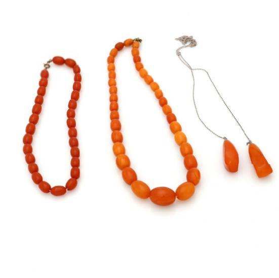 Three amber necklaces respectively of numerous polished amber beads