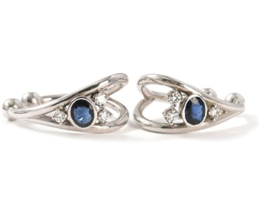 A pair of sapphire and diamond earrings set