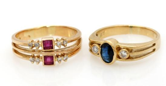 Two rings respectively set with sapphire