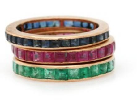 Three eternity rings respectively set with numerous square-cut rubies