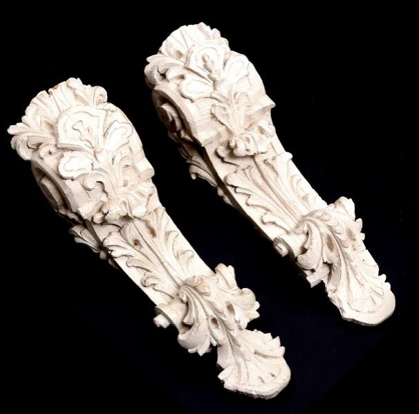 A pair of 18th century whitepainted wood Baroque carvings adorned with scrolls and rocailles