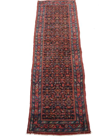 A Persian semi-antique Hamadan runner, embellished with repeating pattern on blue base