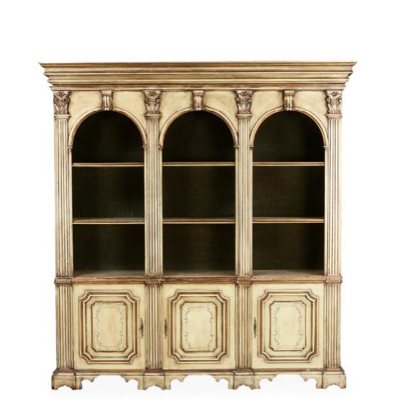 A large Italian baroque style open front bookcase