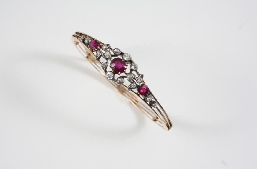 A VICTORIAN RUBY AND DIAMOND HALF HINGED BANGLE