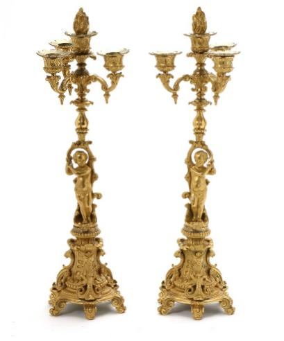 A pair of French belle epoque gilt bronze candelabra each with three lighting arms