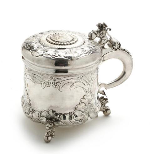 Baroque style silver tankard chased with foliage