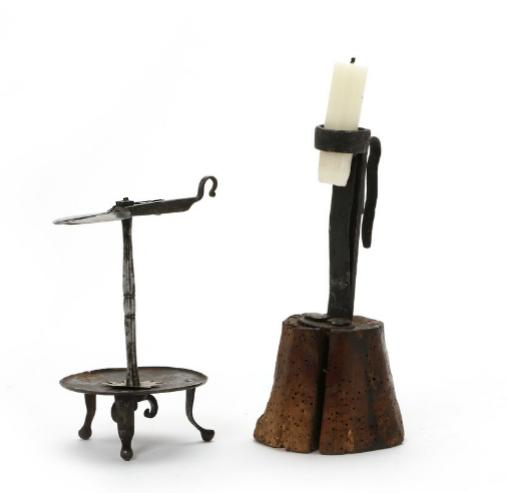 An 18th century iron and brass staple candlestick