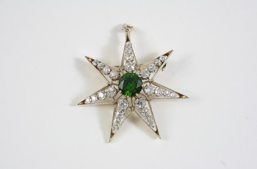 A DIAMOND AND DEMANTOID GARNET STAR BROOCH PENDANT
