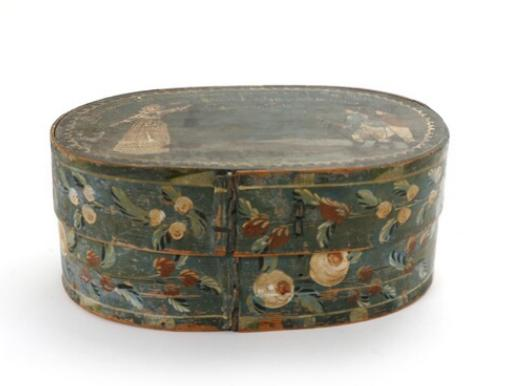 A 19th century German painted shingle wig box of oval shape