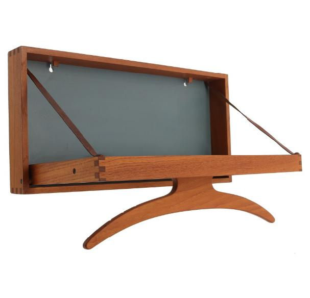 A teak wall hanger with greenish blue lacquered back, full grain leather straps