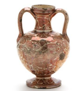 A late 19th century baluster fired clay vase adorned with luster glaze