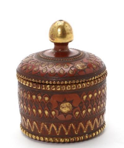 A 20th century Iranian fired clay lidded bowl. Diam. 9 cm.