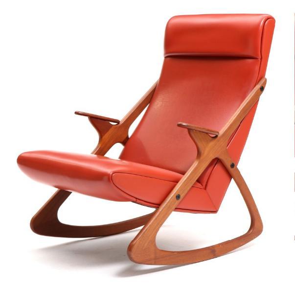 A teak rocking chair