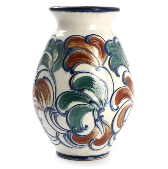 A earthenware vase decorated with brown, blue and brown glaze