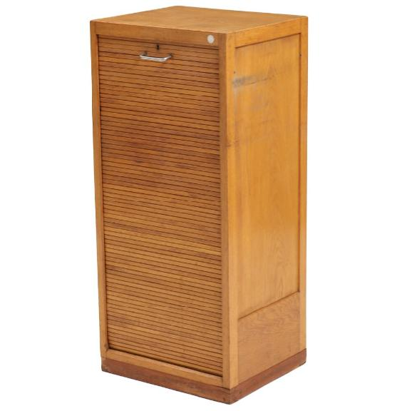 An oak cabinet with roll front and beech interior