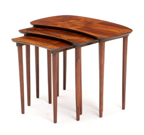 A set of three rosewood nesting tables