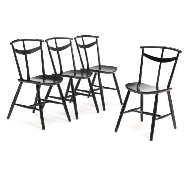 A set of four black lacquered wooden chairs
