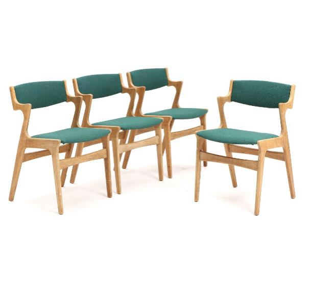 A set of four oak chairs upholstered in seat and back with green wool