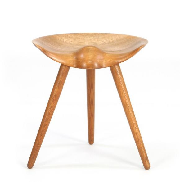 A stool of elm with semi circular seat, mounted on three round, tapering legs