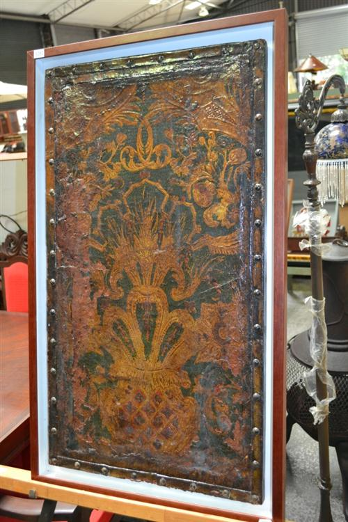 Framed Leather Panel of an C18th Dressing Screen, heightened in gilt. Height: 99 cm