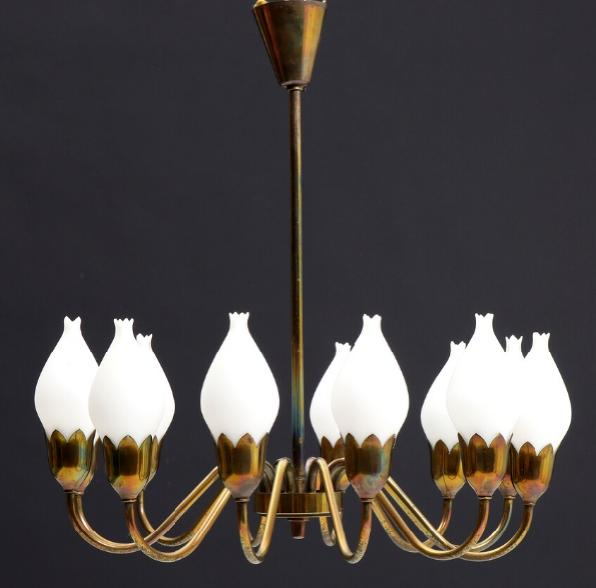 A brass chandelier with 12 light arms.
