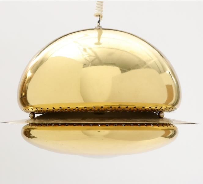 A 1970's brass ceiling lamp