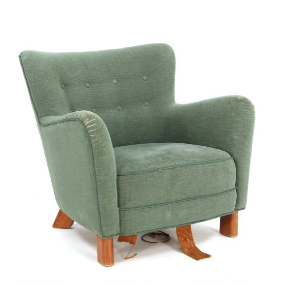 Easy chair with legs of stained beech, upholstered with green wool