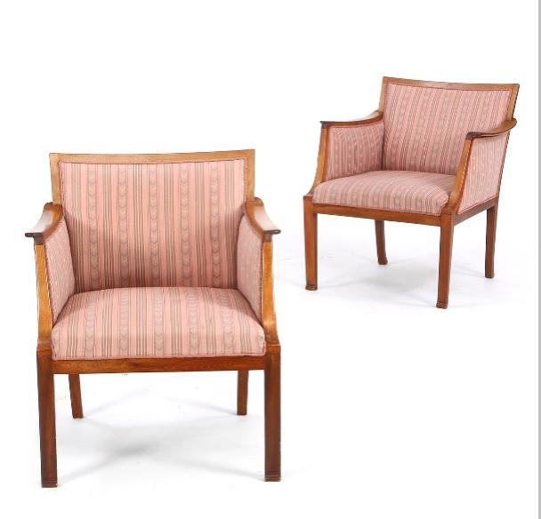 A pair of armchairs with frame of mahogany