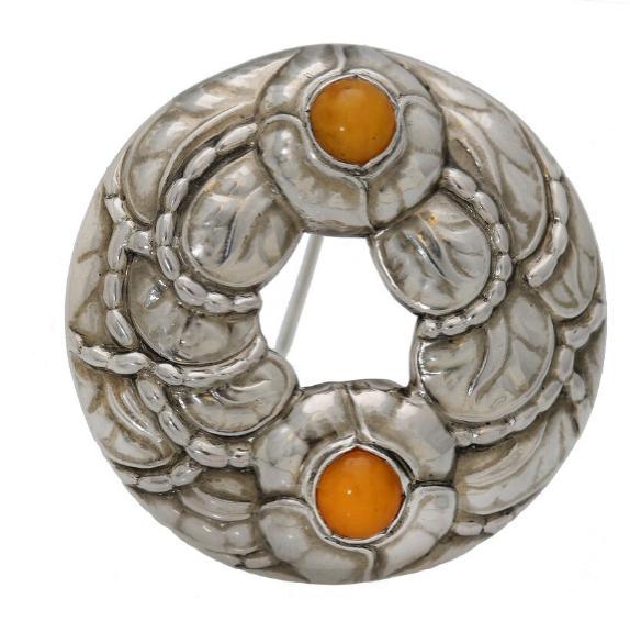 An amber brooch set
