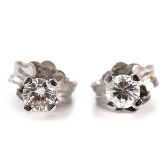 A pair of diamond earrings set