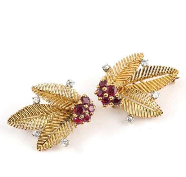 A pair of diamond and ruby brooches set