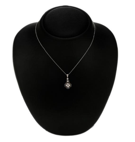 A diamond pendant set