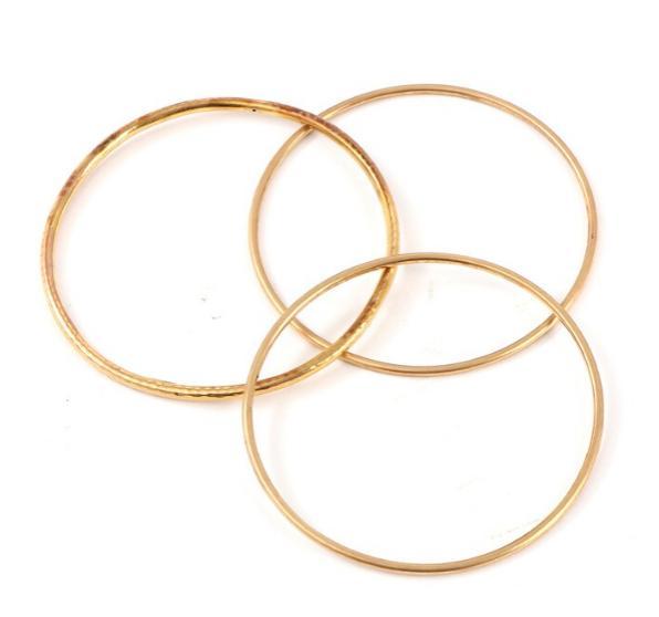 Three 14k gold bangles