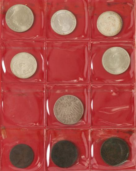 Album with collection of coins from Denmark