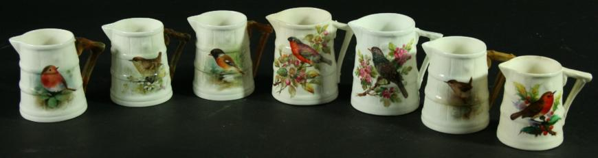 A COLLECTION OF FOUR ROYAL WORCESTER JUGS, three signed Powell or Platt, date ciphers for 1880 and later, painted with Bullfinch