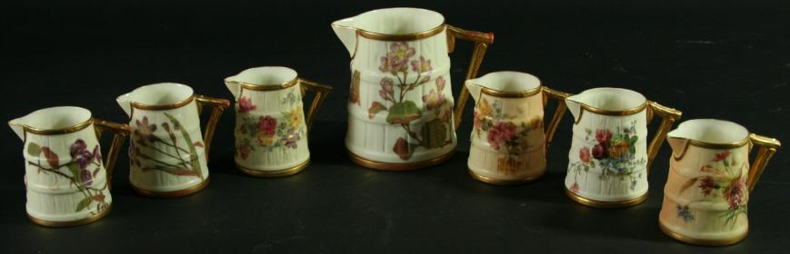 A COLLECTION OF SEVEN ROYAL WORCESTER RUSTIC JUGS