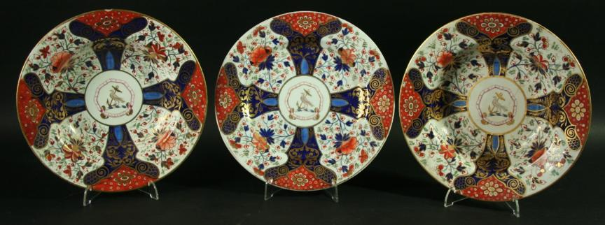 FOUR DERBY ARMORIAL SOUP PLATES