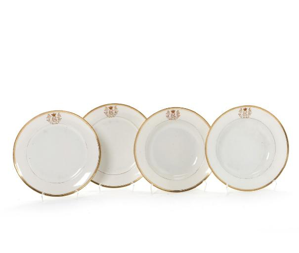 Four porcelain plates decorated in gold and red with King Christian VIII monogram.