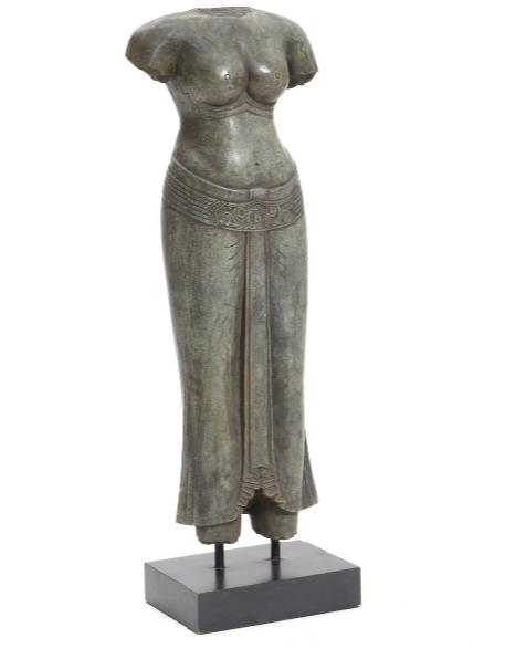 A carved stone figure in the shape of a woman's torso, on a black laminated base