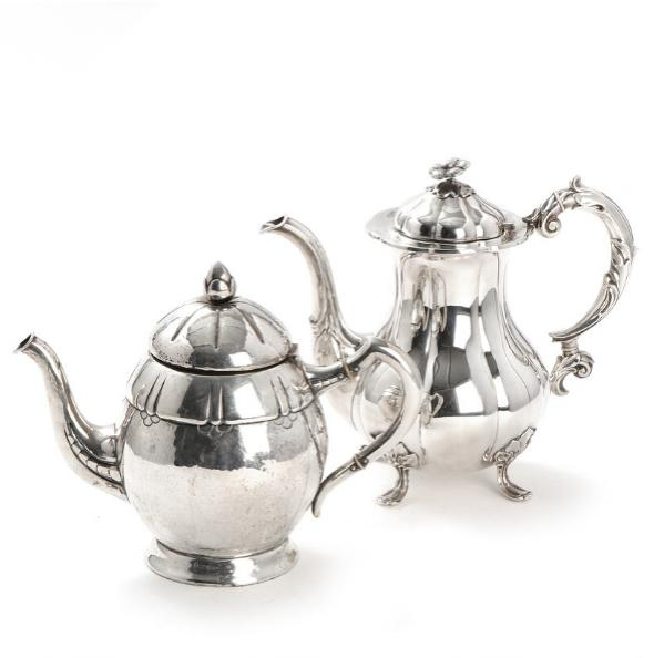 Danish Art Noveau hammered silver coffee pot and a Rococo style silver coffee pot