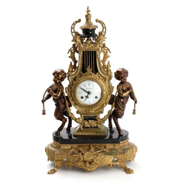 Italian lyre shaped mantel clock, flanked by cherubs holding garland