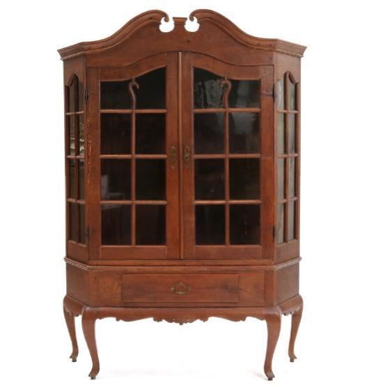 A 19th century Rococo style oak display cabinet